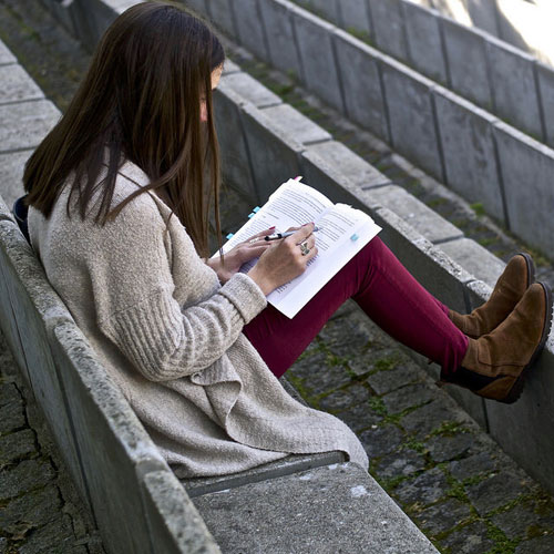 girl studying at park