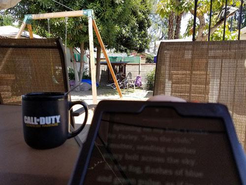 Kindle and mug outside