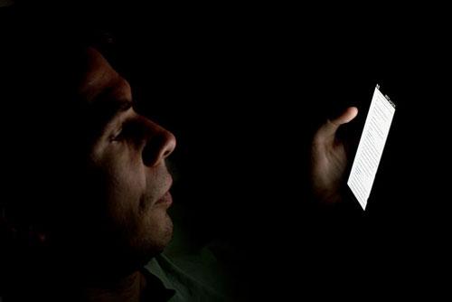 smartphone reading in darkness